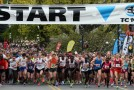 Fast times highlight today's 26th Annual TC10K Kris Swanson sets a course record in the Half Marathon