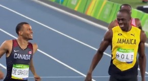 Usain Bolt symbolically passes the torch to Andre De Grasse