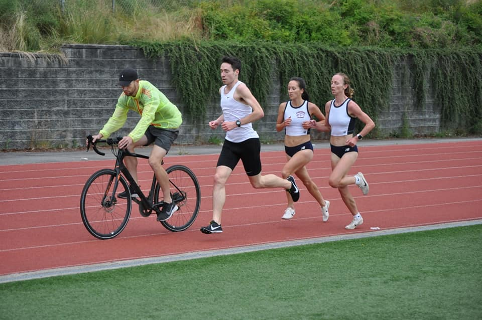 Regan Yee leads Sarah Inglis in 5000m time trial, behind pacer and pacing cyclist